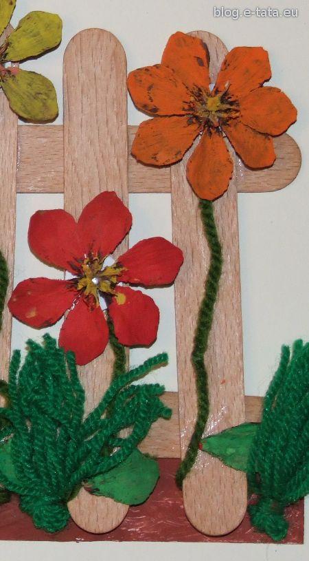 Kwiatki z szyszek na płotku, prezent dla mamy zrobiony samemu przez dzieci