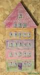 Kalendarz adwentowy, zrobiony z tatą przez dziecko, z tektury i pudełek od zapałek